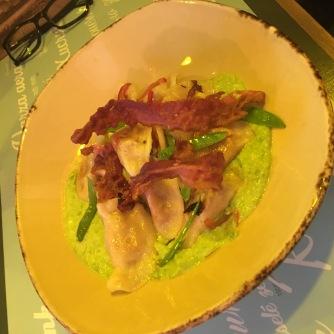 Potato dumplings with bacon over sweet pea puree