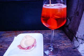 Aperol Spritz and a sandwich
